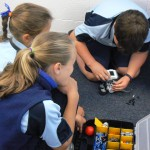 students playing with LEGO