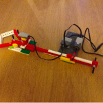 A mechanical grabber controlled by Scratch. It automatically reaches forwards and pulls back objects placed in front of its jaws.